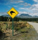 New Zealand kiwi. Road in New Zealand with a sign urging people to drive carefully in order to preserve the national 'kiwi' bird