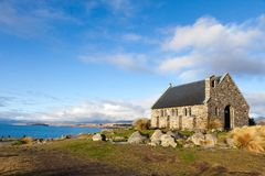 New Zealand lake side view church stock photography