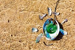 New Zealand - Maori theme - Jade pounamu Koru with Paua shell royalty free stock photos