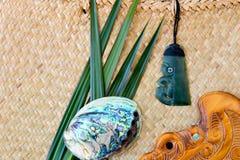 New Zealand - Maori themed objects - Jade Pounamu Tiki Toki, Pau. New Zealand - Maori themed objects - Jade Pounamu Tiki Toki necklace, Paua shell and Wooden Stock Image