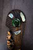New Zealand - Maori themed objects - mere, greenstone and abalone - paua shell royalty free stock images