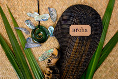 New Zealand - Maori themed objects - mere and greenstone pendant stock photo