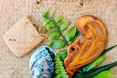 New Zealand - Maori themed objects - Paua shell, Wooden Patu and stock photos