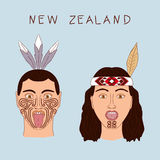 New Zealand Maori tribe a man and a woman. Traditional tattoos ta moko and hats, feathers. Militant grmasy on their Stock Image