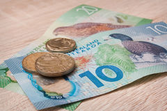 New Zealand Money. Laying on a wooden table Stock Photo