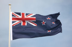 New Zealand National Flag. The New Zealand flag flying in strong wind. Some motion blur on flag edges Stock Photos