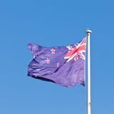 New Zealand national flag banner flying on pole Stock Images