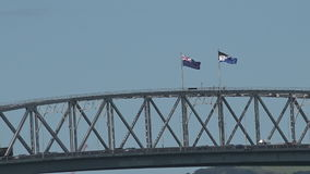 New Zealand National flag and the Silver Fern flag on Auckland Harbour Bridge stock video footage
