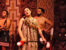 New Zealand: native Maori cultural performance. Maori woman singing and performing poi dance in meeting house marae stock images