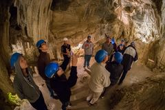 Group oftourist explores the Ngarua Cave in South island of New Zealand. stock photo