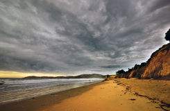 New Zealand Pacific Ocean beach with moody sky Stock Image
