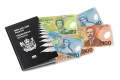 New Zealand passport and cash Stock Photos