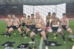 New Zealand Players- Haka. The New Zealand Sevens Rugby team perform the haka as they won the third round of the HSBC Sevens world series by beating france inthe Stock Image