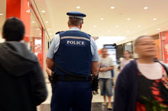 New Zealand police officers patrol in a mall in Auckland Royalty Free Stock Photography
