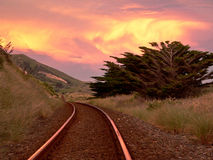 New Zealand railroad track. A railroad track with great cloudscape in New Zealand Royalty Free Stock Photos