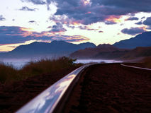 New Zealand railroad track. A railroad track with great cloudscape at New Zealands eastcoast Stock Photo