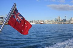 The New Zealand Red Ensign. Wave against Auckland city skyline, New Zealand stock photos