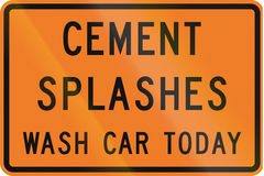 New Zealand road sign - Cement splashes, wash your car today to prevent damage Stock Image
