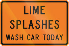 New Zealand road sign - Lime splashes, wash your car today to prevent damage Royalty Free Stock Images