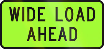 New Zealand road sign - Over-dimension vehicle transporting a extra wide load ahead.  stock illustration