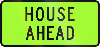 New Zealand road sign - Over-dimension vehicle transporting a house ahead Stock Image