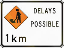 New Zealand road sign - Road workers ahead in 1 kilometre, delays possible Stock Photography