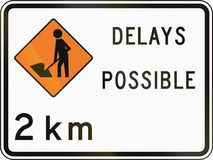 New Zealand road sign - Road workers ahead in 2 kilometres, delays possible Royalty Free Stock Photography