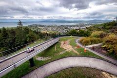Recreation image of person riding on Skyline Rotorua Luge stock photo