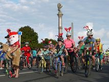 New Zealand: small town Christmas parade cyclist families royalty free stock photo