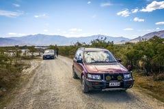 All terrain vehicle runs along the gravel track in New Zealand stock photo