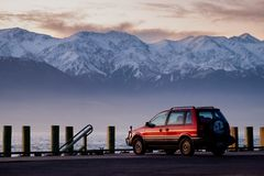 Red 1995 Mitsubishi RVR 4WD vehicle parks at the coast line of Kaikoura stock images