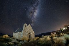 Famous tourist attraction of Church at Lake Tekapo with milky way galaxy, New Zealand at night stock image