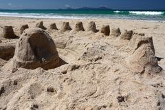 New Zealand: summer beach sand castles h. Beach in summer with sand castles, Langs Beach, Northland, New Zealand - horizontal format royalty free stock photography