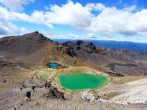 New zealand tongariro crossing national park volcano blue lake, emerald lakes. Volcanic rocks blue lake and a sunny day to hike. 19 km hiking in tongariro alpine stock photos