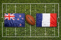 New Zealand vs. France flags on rugby field Stock Photos