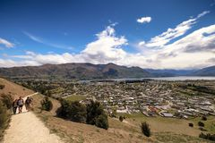 Scenic aerial view of tourists climbing elephant hill at wanaka, New Zealand royalty free stock photography