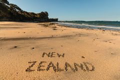 New Zealand written in sand Royalty Free Stock Photos