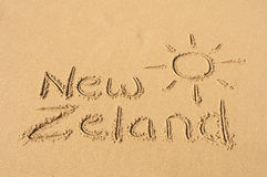 New Zeland in the Sand. A picture of the sun and the word New Zeland drawn in the sand Stock Photo