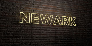 NEWARK - ρεαλιστικό σημάδι νέου στο υπόβαθρο τουβλότοιχος - τρισδιάστατο δικαίωμα ελεύθερη εικόνα αποθεμάτων Στοκ εικόνες με δικαίωμα ελεύθερης χρήσης