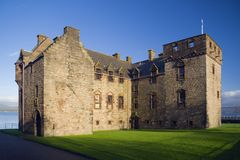 Newark castle. Lit by a low sun, Port Glasgow, Scotland royalty free stock photography