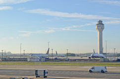 Newark International Airport. Control tower and airplanes on a sunny morning at Newark international airport Royalty Free Stock Photos