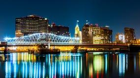 Newark, NJ cityscape by night. Viewed from Riverbank park. Jackson street bridge, illuminated, spans the Passaic River Stock Photo