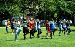 Newark, NJ: Marching Band at Practise. Members of a local high school marching band practising a routine with their coach (in blue tee-shirt) at Military Park in Stock Image