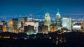 Newark, NJ, skyline. On a hazy night with Verrazano Narrows bridge in the background Royalty Free Stock Photos