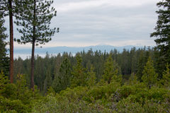 Newberry National Volcanic Monument. Scenic view over some snow-capped mountain peaks (maybe Mount Bachelor and South Sister) and fog in the valleys Stock Photography
