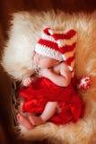 Newborn младенец в красной юбке Стоковое фото RF