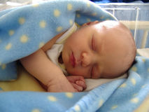 Newborn. Colourful image of a 1-day old sleeping baby stock images