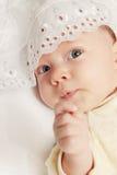 Newborn. Portrait of the newborn in the white cover Stock Photo