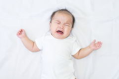 Newborn Asian baby crying Stock Images