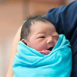 Newborn Asian baby girl and father Royalty Free Stock Photography